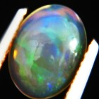 untreated crystal fire rainbow colored oval water welo opal in flat cabochon half single