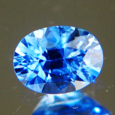 cornflower blue oval cut brilliant sapphire from Ceylon, unheated and natural, no window, IGI report