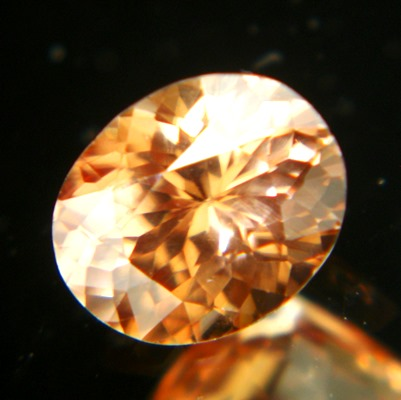precision cut unheated orange pink padparadscha zircon from Sri Lanka in oval precision cut