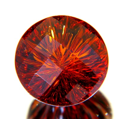 Untreated round precision cut concave hessonite