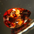 dark topaz free of treatments, deep golden orange gem, over ten carats
