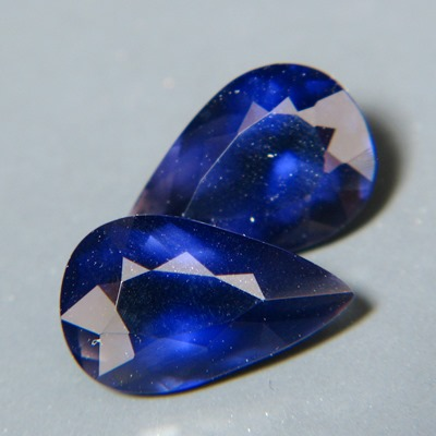 matching pair of certified untreated extra large iolites in dark blue
