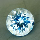 neon blue aquamarine free of treatments, round and near 5 carat