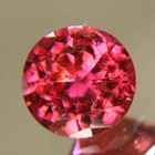 deep red-orange rubelite free of treatments, round and over 6 carat