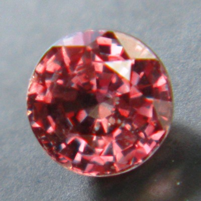 small but brilliant unheated red purple sapphire from Tanzania