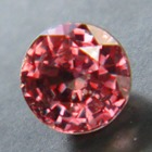small but brilliant unheated red purple sapphire from Tanzania
