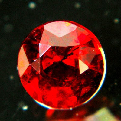 pure red round brilliant clinohumite unheated and natural, free of inclusions, IGI report included