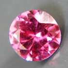 small but shiny unheated red purple rhodolite from Tanzania