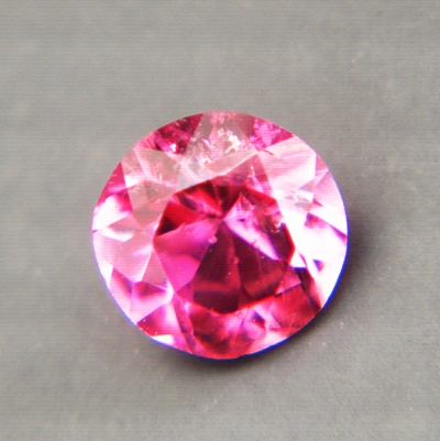 neon red rubellite, free of treatments, no window, no black-out even in low light