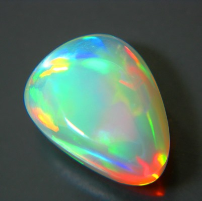 water opal over 4 carats with untreated all colors in neon welo opal pear shape with broad flames an