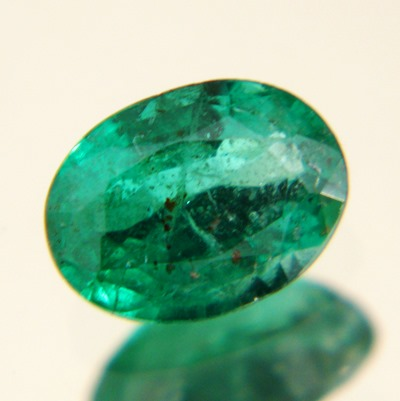 oval zambian sub carat emerald with big face but no window pure green