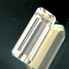yellow spodumene without inclusions or treatments in fine emerald cut IGI report included