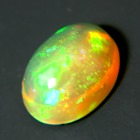 untreated fire rainbow colored oval water orange welo opal in cabochon half single