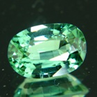 sea-foam green tourmaline with a small window and paraiba ambition