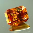Rainbow in orange African titanite