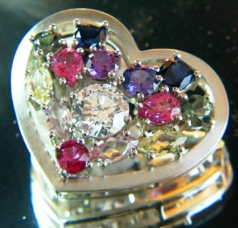 untreated sapphire rainbow set and rubies and padparadschas and diamonds in gold pendant
