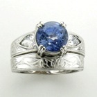 untreated blue sapphire set in 18k white gold ring