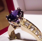 natural dark blue changing color sapphire set in gold and diamonds ring