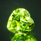 well cut unheated neon green yellow peridot in heart shape and IGI report