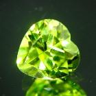 well cut unheated neon green yellow peridot in heart shape and IGI report