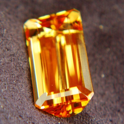 imperial topaz free of treatments, bright golden orange gem, near ten carats emerald shaped