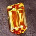 imperial topaz free of treatments, bright golden orange gem, near ten carats emerald shaped
