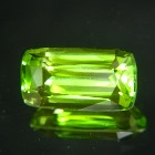 well cut unheated fine green clean peridot in long cushion shape and IGI report near ten carats