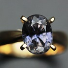 untreated multicolour sapphire in 4 prongs gold ring