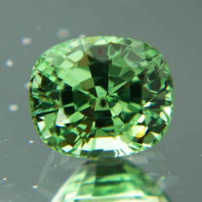 bright green tsavorite in cushion 1.5 carat