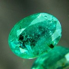 oval columbian one carat emerald with silky blue crystal