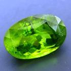 classic oval, deep jungle green pakistani peridot free of treatments over sixteen carat