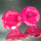 pear red no-heat sapphires (ruby) as pair in best blood color and earing shape