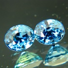 untreated blue sapphires over in exactly matching pair ovals