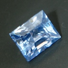 cold sky blue rectangular pyramid cut sapphire from Ceylon, unheated and natural, no window, IGI rep