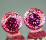 Rich orange pink pair of Malaya garnets