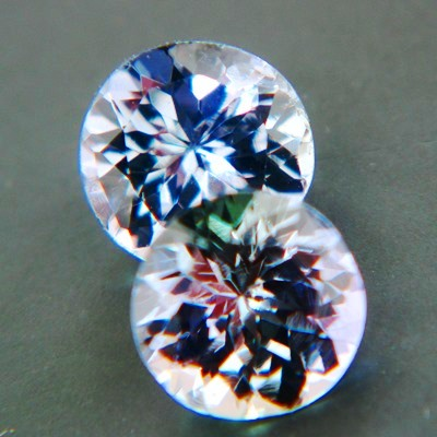 matching pair of certified unheated untreated multicolor tanzanite in round