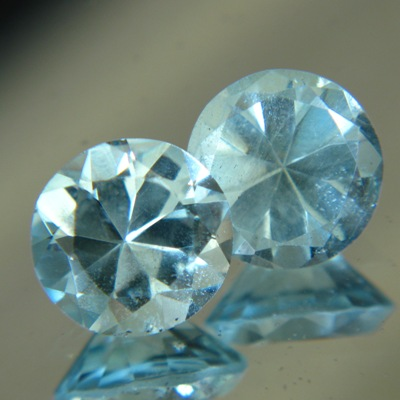 untreated blue green beryls over seven carat in exactly matching pair round brilliants.