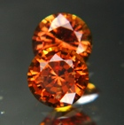 pair of natural orange sapphires