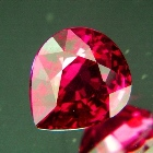 unheated deep orange pink-red pear rhodolite from africa over 5 carats