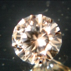 unheated golden pink round zircon from Sri Lanka in precision cut, no window, no inclusions, no trea