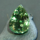 Russian color change alexandrite with IGI report changing from vivid green to brown red