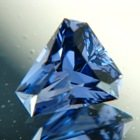 Deep steel blue Tanzanian spinel in unique precision cut