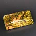 untreated green-orange-yellow gemstone called Unakite