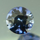 dark natural round sapphire precision cut to set on ring