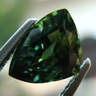 dark green triangular shape sapphire no heat and untreated