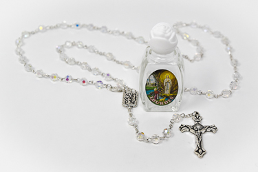 Rosary Beads & Bottle of Lourdes Water.