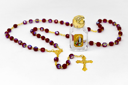 Ruby Rosary & Bottle of Lourdes Water.