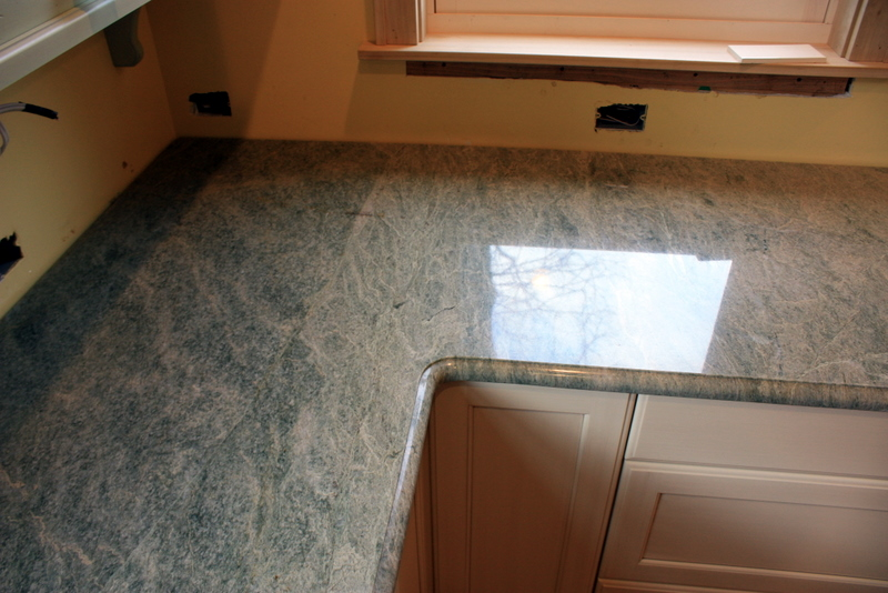 gray transitional countertops counter granite photo with window kitchen corner countertop island over htm curved stove
