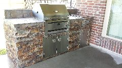 Stone Outdoor Kitchen with Charcoal Grill