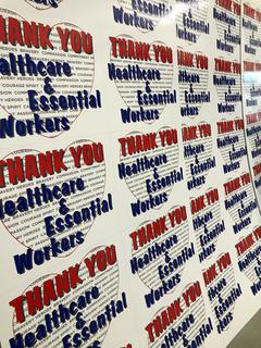 Essential worker appreciation yard signs waiting to be cut down. Syracuse, NY